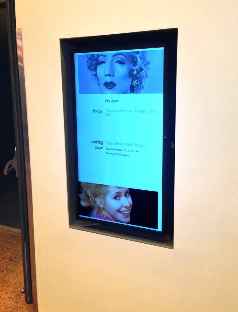 New HD monitor in museum lobby populated by web content.