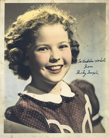 Studio portrait of Shirley Temple with handwritten inscription: To Andrew Worhola from Shirley Temple.