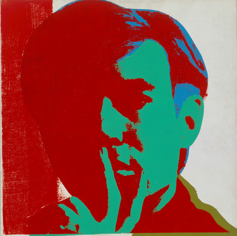 A screen printed self portrait of Andy Warhol, holding the fingers of one hand to his lips. Red shadow overtakes much of his otherwise green face. Part of his hair is highlighted in blue, and part of his collar in gold.