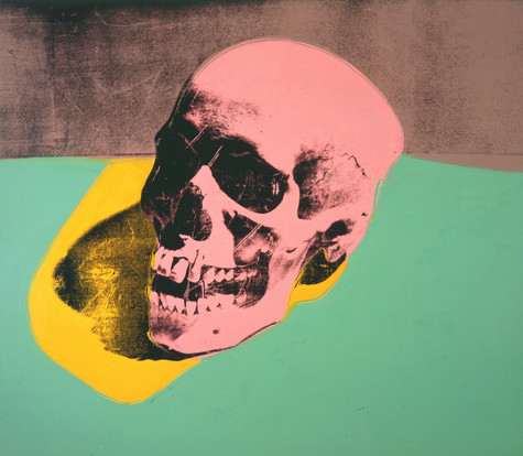 A screen print of a pink skull on a green surface. The shadow the skull is overlaid with yellow.
