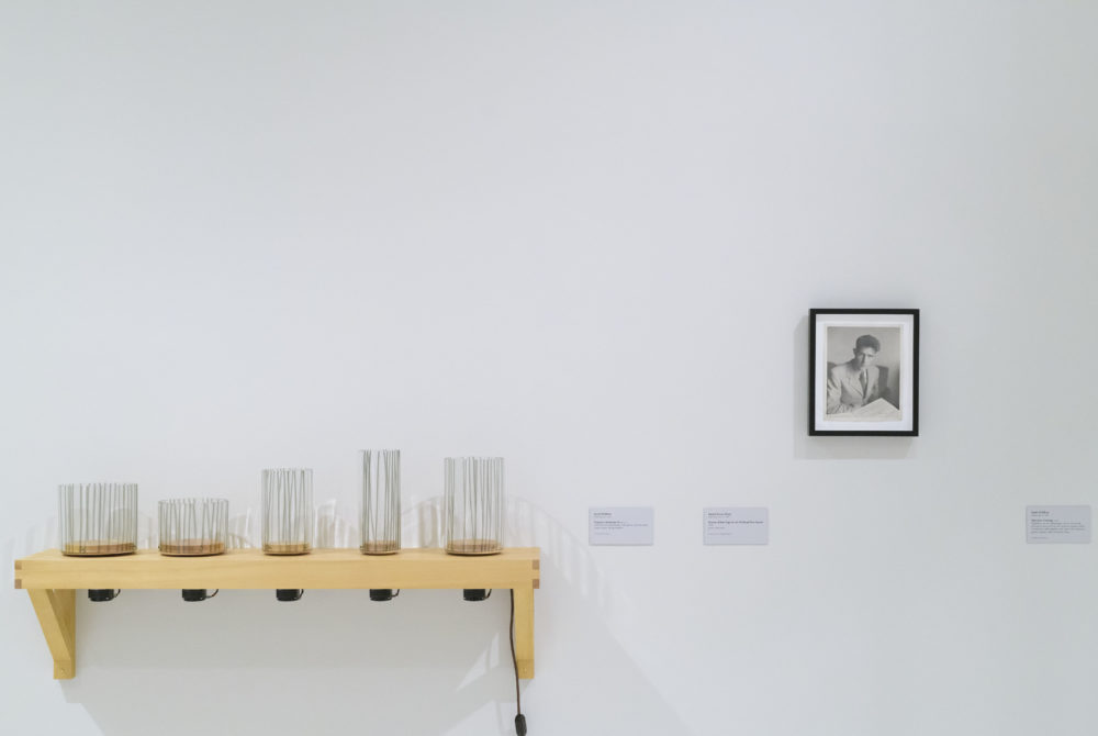 A gallery with white walls that includes various artwork installations.