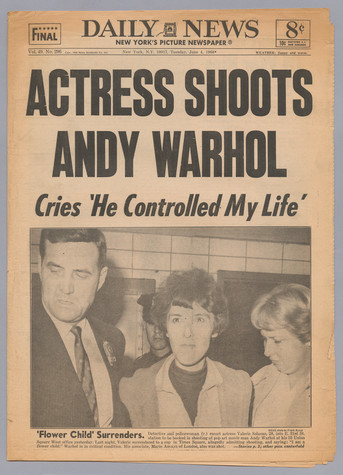 The New York Daily News newspaper with a headline that reads Actress Shoots Andy Warhol / Cries 'He Controlled My Life'. There is a photo of a detective and police woman with another woman (Valerie Solanas) in the middle.