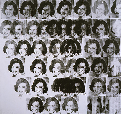 A screenprint of a person's face in black many times over a silver canvas.